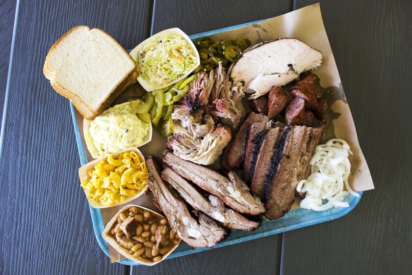 HUNTINGTON PARK, CA - AUGUST 9, 2017 : A smorgasbord of items from the menu at Ray's BBQ includes pork ribs, beef brisket, pulled pork, turkey breast and sausages on August 9, 2017 in Huntington Park, California.(Gina Ferazzi / Los Angeles Times)