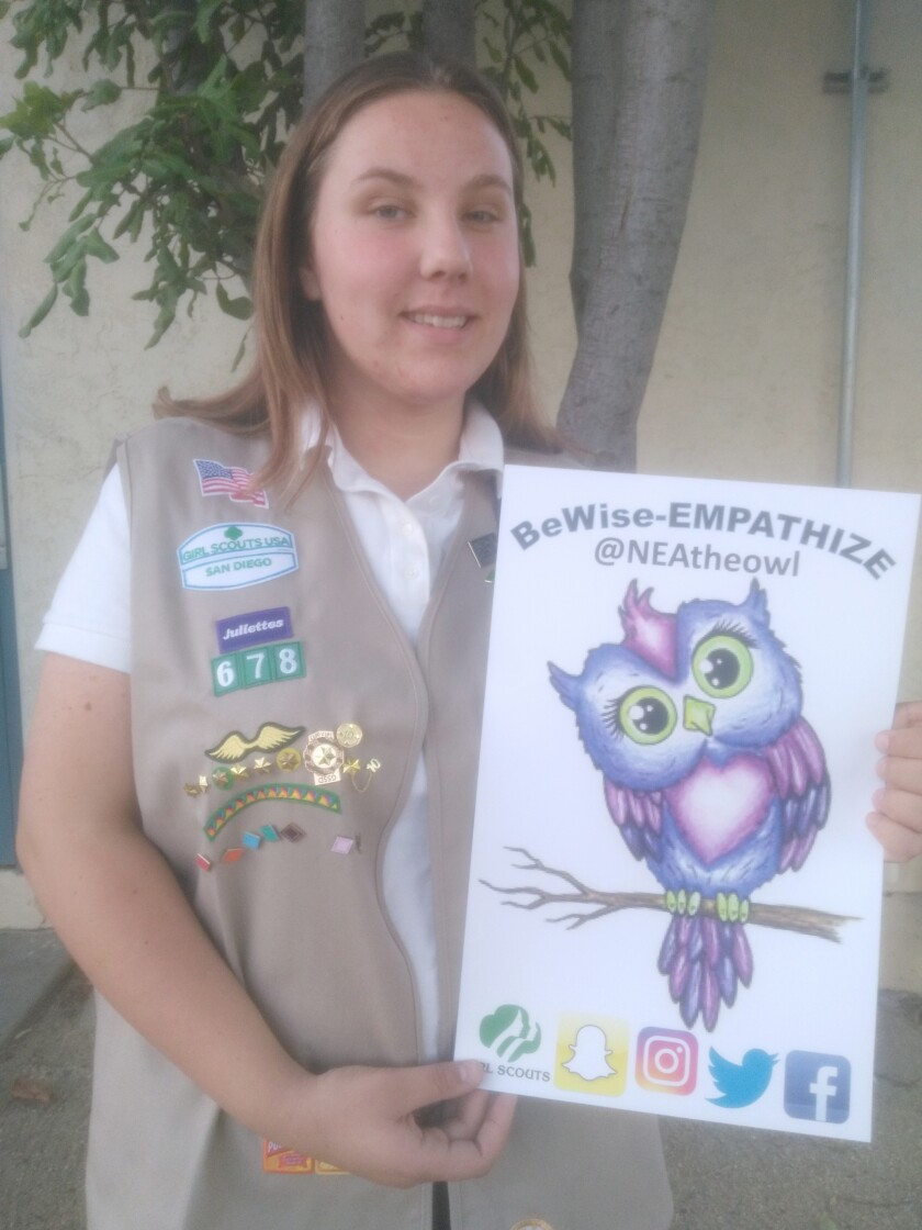 """Ramona High School junior Kelly Seweryn displays one of the posters she designed with a friend to promote empathy. Seweryn's """"BeWise-EMPATHIZE"""" campaign will hopefully lead to a Girl Scouts Gold Award."""