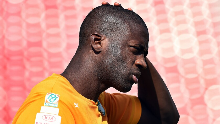 Ivory Coast midfielder Yaya Toure arrives for a training session in Frisco, Texas, on Tuesday. The West African nation hopes the team's high level of experience will make for a memorable World Cup effort.