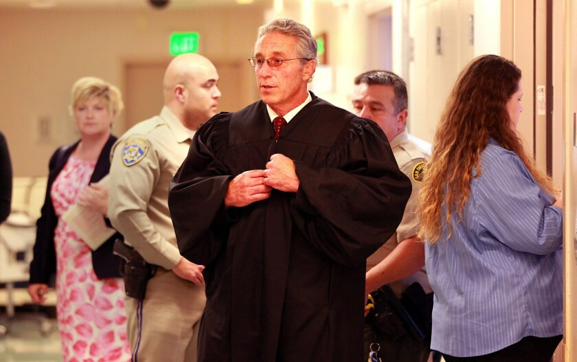 San Diego Superior Court Judge Peter Deddeh walks from a room at UCSD hospital after arraigning Jason King in a DUI accident which killed two and seriouly injured three people on the 163 as he was traveling south in northbound lanes.
