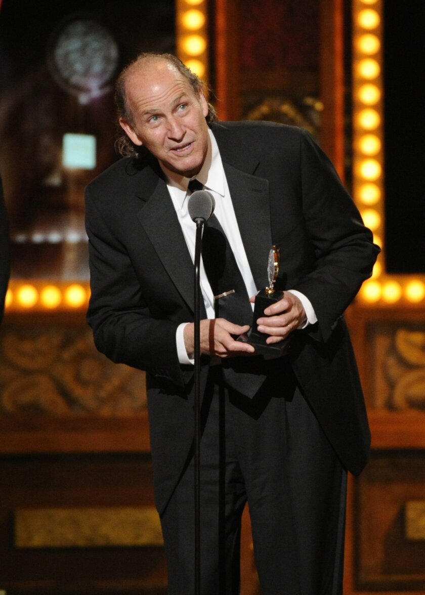 """Steve Canyon Kennedy accepts the award for best sound design of a play for """"Lady Day at Emerson's Bar & Grill"""" onstage at the 68th annual Tony Awards at Radio City Music Hall on Sunday, June 8, 2014, in New York. (Photo by Evan Agostini/Invision/AP)"""