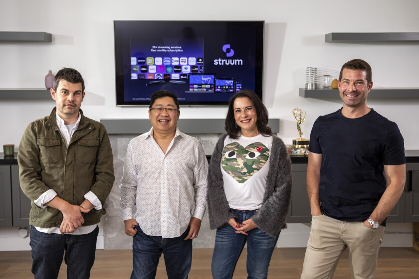 Thomas Wadsworth, Eugene Liew, Lauren DeVillier and Paul Pastor stand inside Liew's home office in Los Angeles