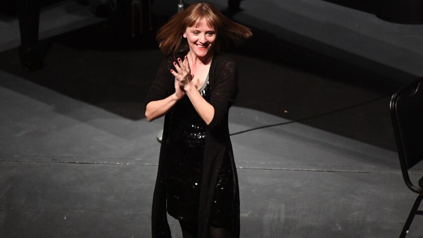 "Ellen Reid acknowledges the audience for the Los Angeles Chamber Orchestra premiere of ""Petrichor"" at UCLA's Royce Hall."
