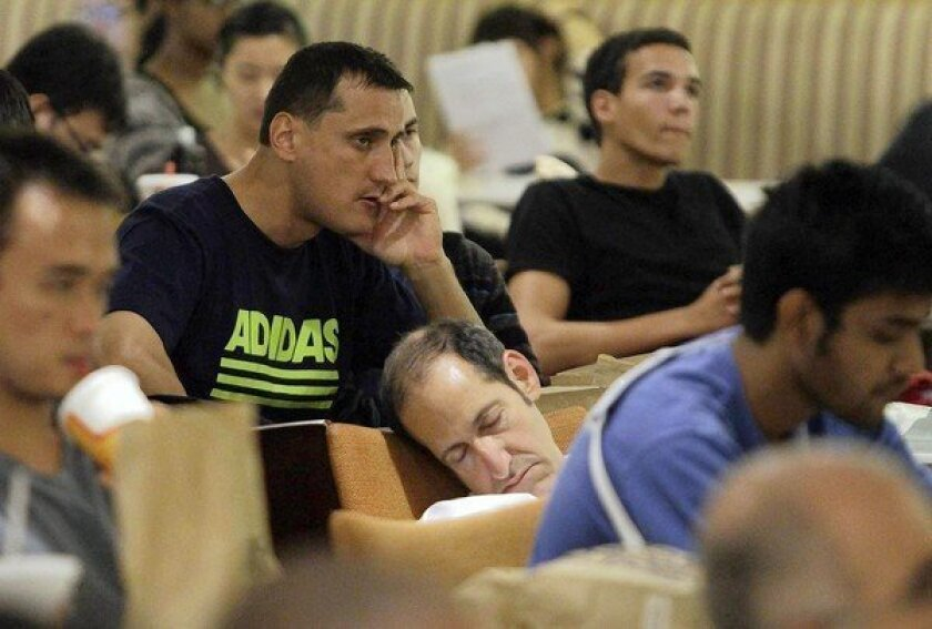 An attendee snoozes at a gathering at UCLA's Ackerman Hall to watch the presidential debate, which was a subdued, even boring, encounter.