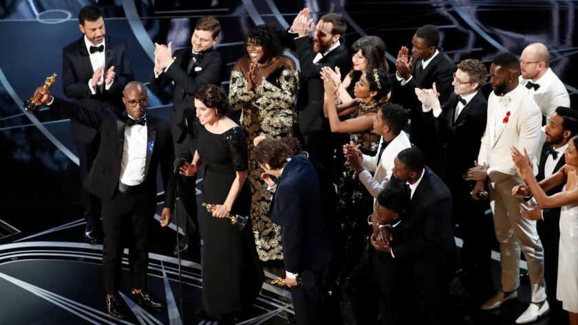 """Barry Jenkins accepts the Oscar as """"Moonlight"""" wins for best picture during the telecast of the 89th Academy Awards."""