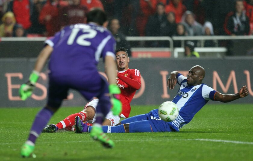 Benfica's Benfica's Andre Almeida, center, challenges Porto goalkeeper Iker Casillas, left, and Porto's Bruno Martins Indi during their Portuguese league soccer match at Benfica's Luz stadium in Lisbon, Friday, Feb. 12, 2016. (Armando Franca)