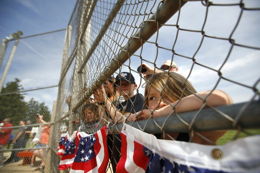 Presley Gray, 5, of Dayton, Ohio, watches as Hall of Famer John Smoltz throws a few pitches during the Baseball Hall of Fame Tour at the Field of Dreams movie site, in Dyersville, Iowa, Thursday, May 26, 2016. (Mike Burley/Telegraph Herald via AP)