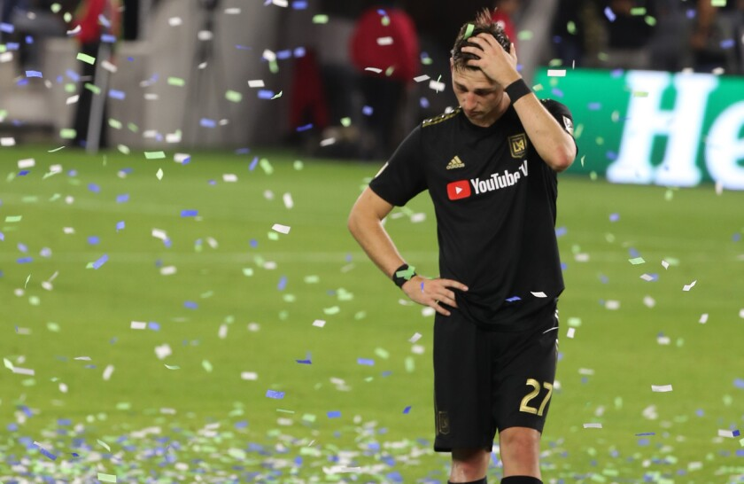 LAFC defender Tristan Blackmon walks off the field confetti rains down.