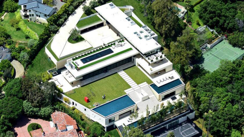 Jay-Z and Beyoncé's new home in Bel-Air has 30,000 square feet of living space, four pools and a wellness center.