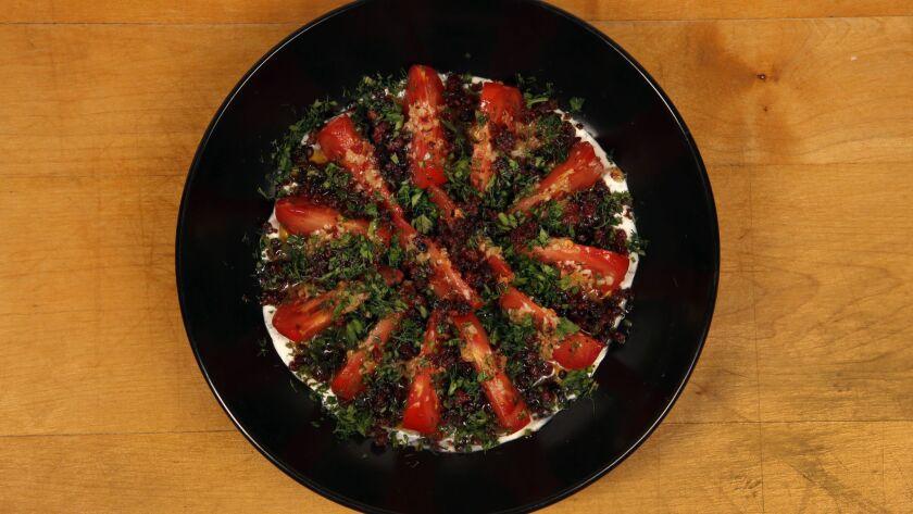 LOS ANGELES CA. OCTOBER 11, 2017: The heiloom tomato bagna cauda recipe with lap xuong, creme fraic