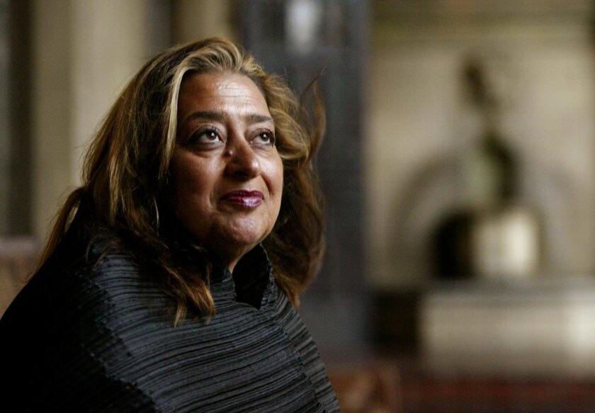FILE- In this March 21, 2004 file picture, Iraqi-British architect Zaha Hadid poses in West Hollywood, Calif. Hadid, whose modernist, futuristic designs included the swooping aquatic center for the 2012 London Olympics, has died aged 65, Thursday, March 31, 2016. (AP Photo/Kevork Djansezian, File)