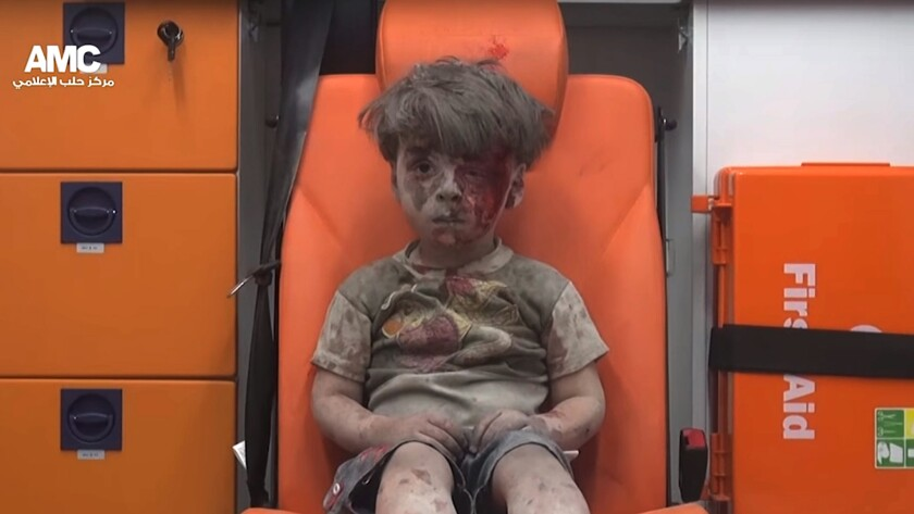 A screenshot from a video by the Syrian activist group Aleppo Media Center shows a 4-year-old boy sitting in an ambulance after airstrikes in Aleppo, Syria, last month.