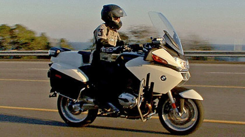 ON PATROL: Susan Carpenter takes a spin on the BMW R1200RT-P. The paint screams motorcycle cop.