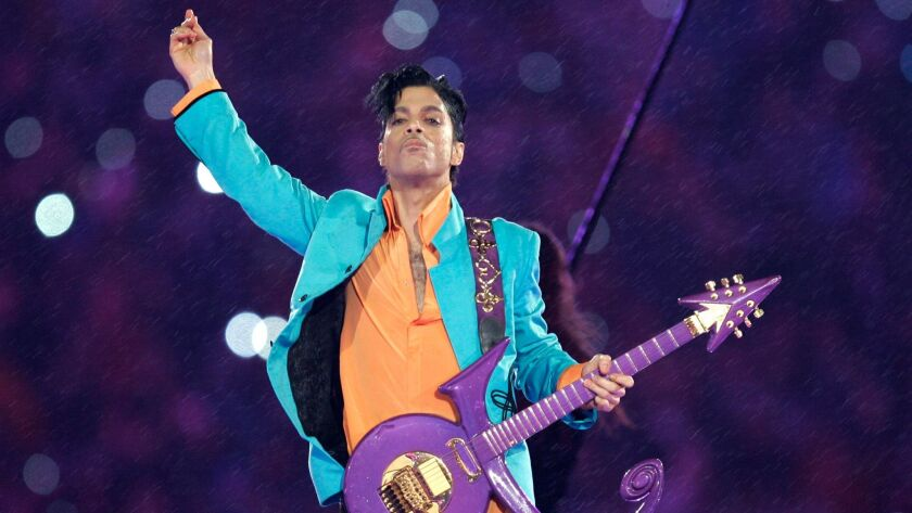 FILE - In this Feb. 4, 2007, file photo, Prince performs during the halftime show at the Super Bowl
