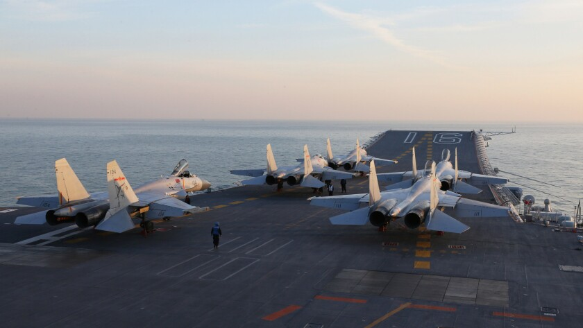 Chinese J-15 fighter jets are seen waiting on the deck of the aircraft carrier Liaoning in December 2016 during military drills in the Bohai Sea, off China's northeastern coast, as tensions with the U.S. and Taiwan escalate.