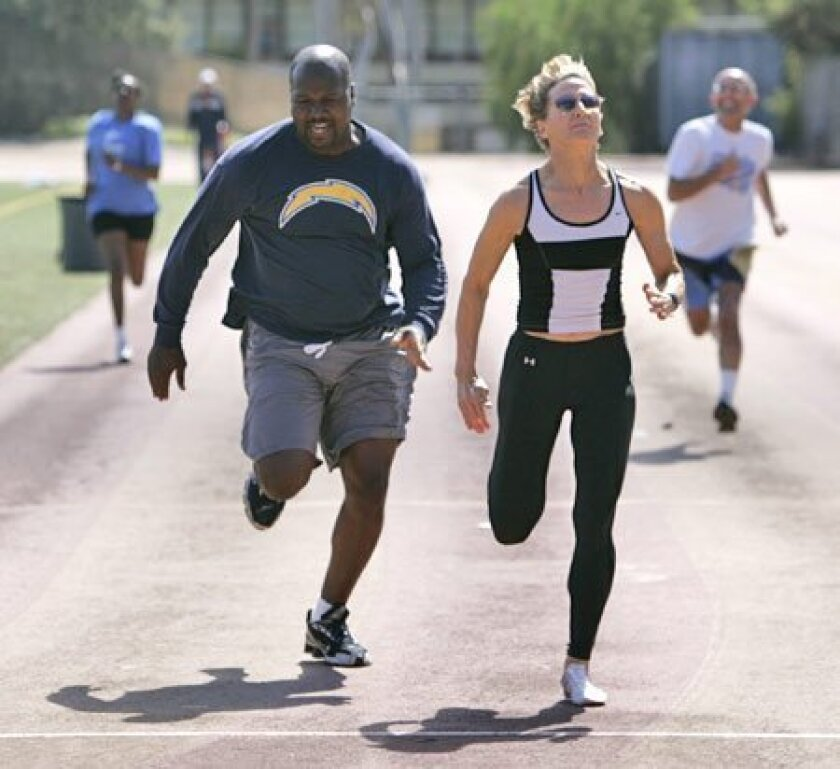 Rita Hanscom (second from right) outruns Olun Graves and other California Department of Justice employees.  (K.C. Alfred / Union-Tribune)