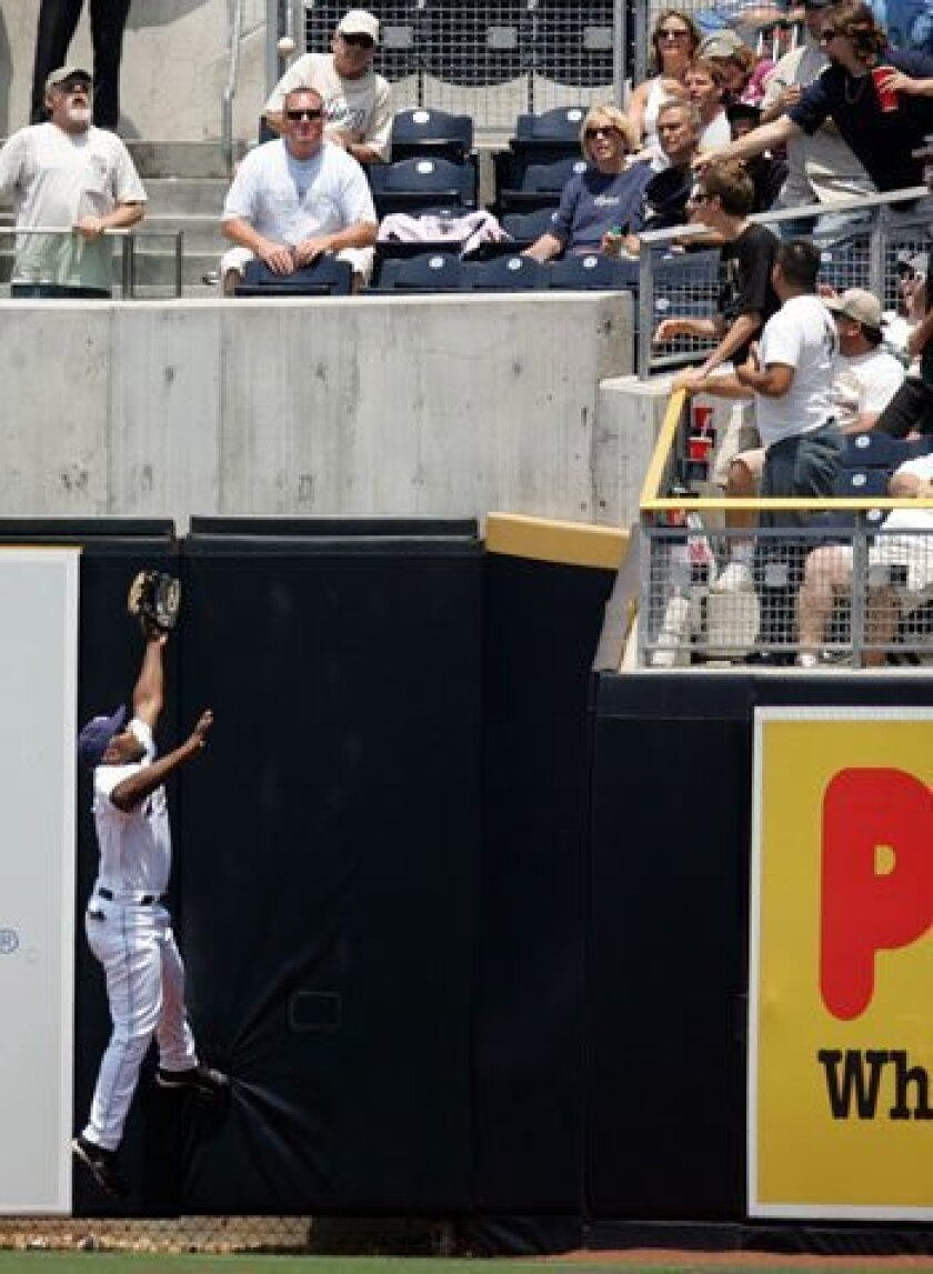 Padres right fielder Chip Ambres can only watch as this home run ball from Florida's Mike Jacobs goes over his head in the fourth inning, scoring two runs for the Marlins.