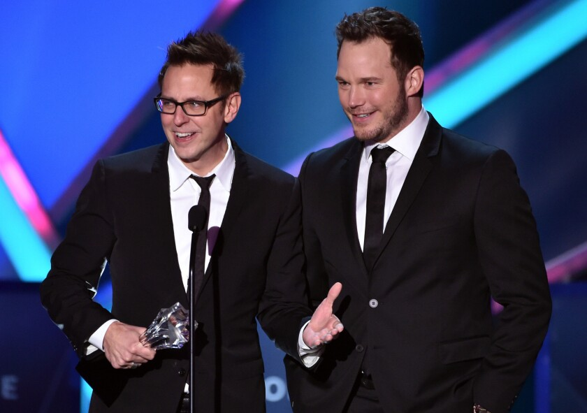 """Director and writer James Gunn, left, and actor Chris Pratt accept the action movie award for """"Guardians of the Galaxy."""""""