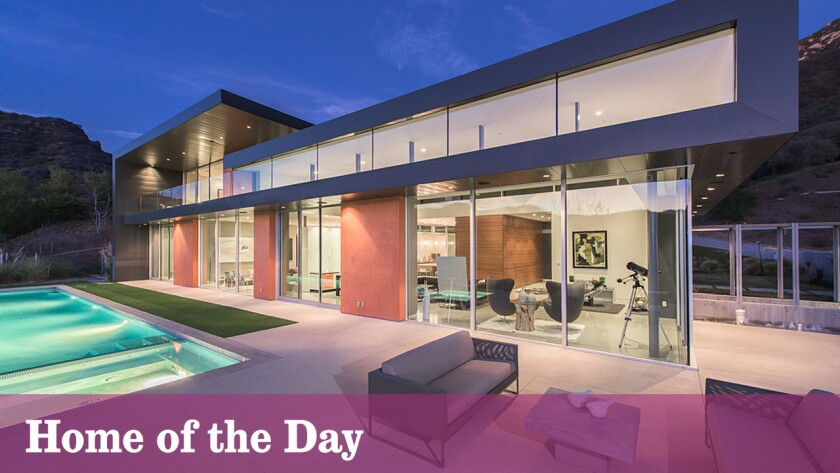 Walls of glass and a saltwater swimming pool are among features of this newly listed home in Calabasas.