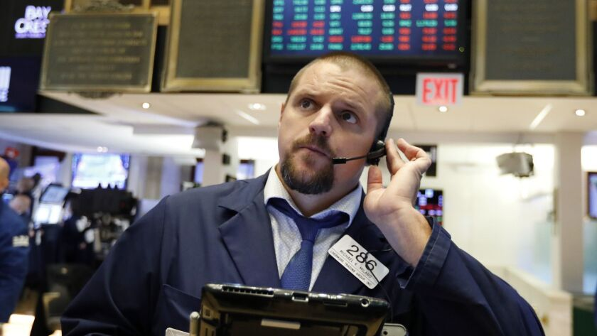 A trader works on the floor of the New York Stock Exchange on Sept. 14.