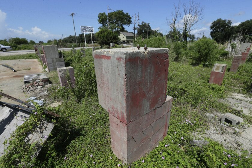 Remnants of a car wash destroyed by Hurricane Rita, nearly ten years ago, remain in Cameron, La., Tuesday, Sept. 15, 2015. A decade after Hurricane Rita, Cameron Parish in coastal, southwest Louisiana still bears the scars of her wrath. Thursday, Sept. 24 is the anniversary of Hurricane Rita. (AP Photo/Gerald Herbert)