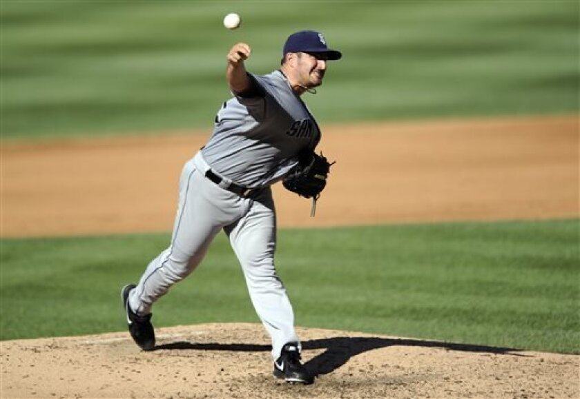 San Diego Padres starting pitcher Jason Marquis delivers against the Washington Nationals during the fourth inning of a baseball game on Saturday, July 6, 2013, in Washington. The Nationals won 5-4. (AP Photo/Nick Wass)