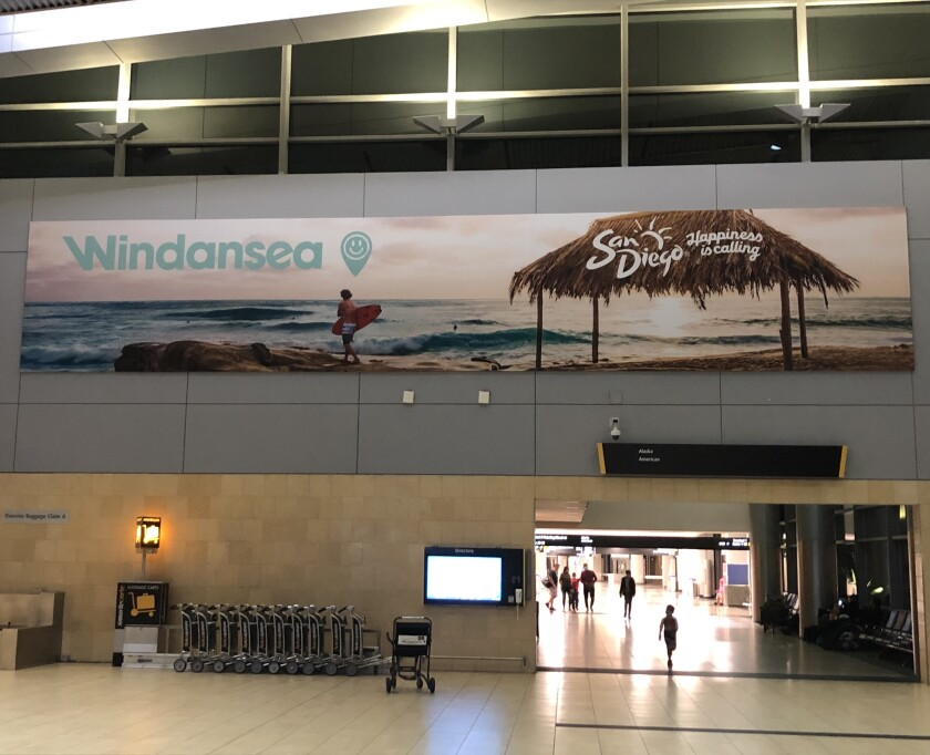 This sign in San Diego International Airport depicts La Jolla's Windansea Beach.