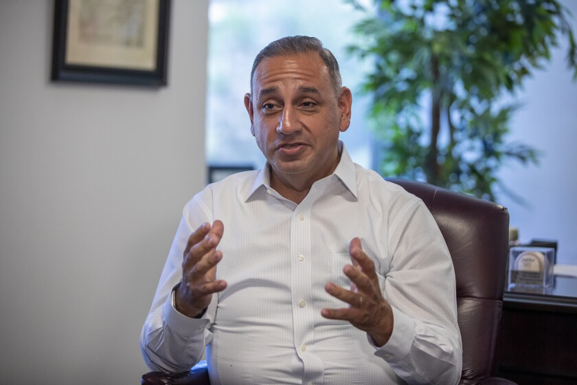 Rep. Gil Cisneros of Yorba Linda talks to constituents at his office in Fullerton in July 2019. The freshman Democrat was one of seven lawmakers whose call for an impeachment investigation swayed others in the House.