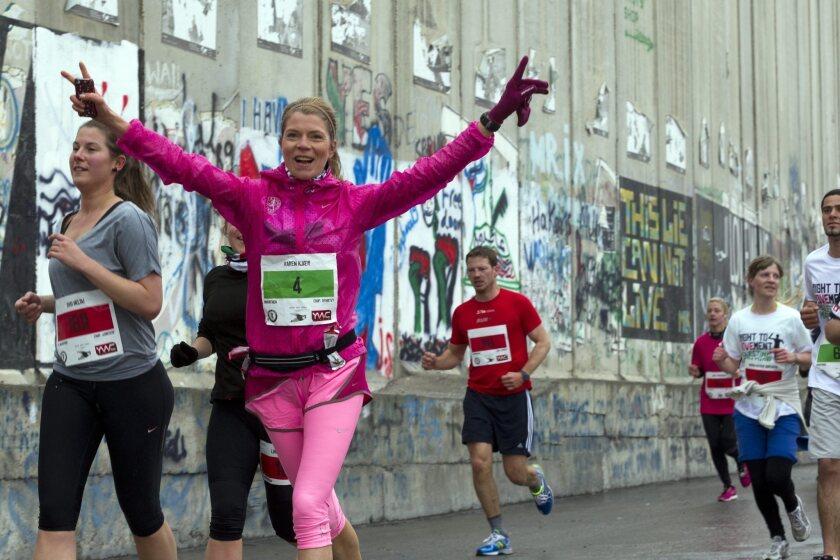 Palestinian marathon kicks off with tribute to Boston victims