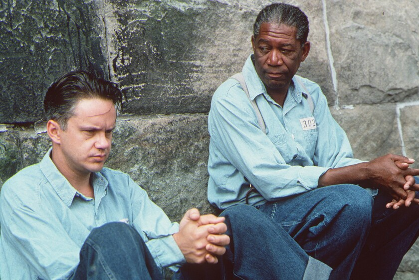 Andy (Tim Robbins, left) and Red (Morgan Freeman, right) are inmates in Castle Rock Entertainment's