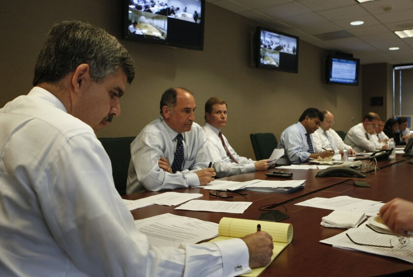 Mohamed El-Erian, left, Pimco's chief executive, presides over a meeting of the nine-member investment committee -- basically, the firm's brain trust, which makes major investment decisions