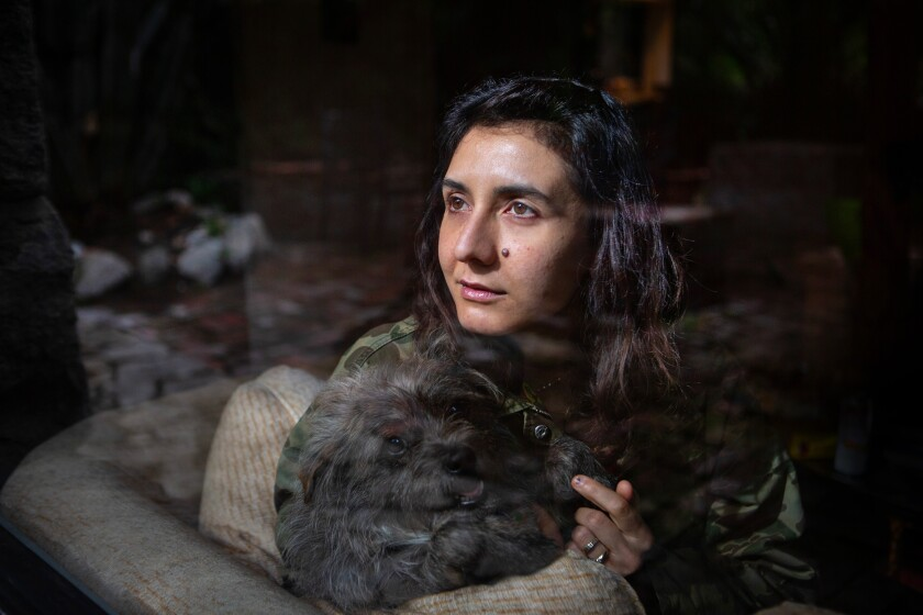 Novelist Ottessa Moshfegh with her dog, Jewely, at her home at the base of the Angeles National Forest