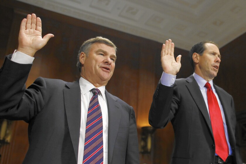 DirecTV Chief Executive Michael D. White, left, and AT&T CEO Randall L. Stephenson are sworn in before testifying at a Senate subcommittee hearing about their companies' proposed merger in June 2014.