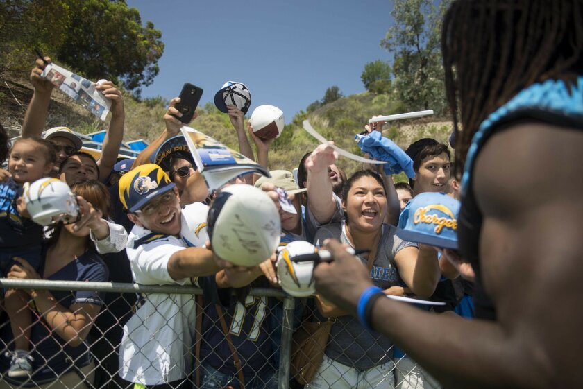 Fans struggle to get the attention and autograph from the Chargers first round draft pick Mevlin Gordon after the first day of Chargers training camp on July 30, 2015 at Chargers Park. .