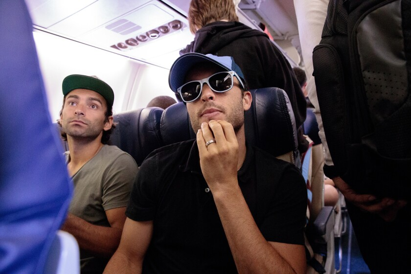 Landon Donovan, center, and Galaxy teammate Baggio Husidic try to get comfortable on a flight taking the team to a game against Sporting Kansas City two weeks ago.