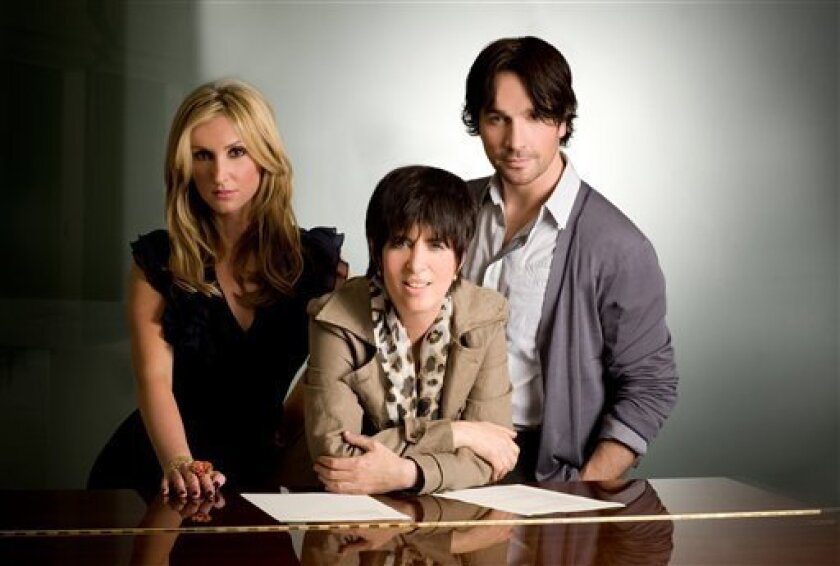In this undated publicity image released by Chasen & Company, songwriter Diane Warren, center, poses with Kelly Levesque, left, and Tyler Hamilton of Due Voci. (AP Photo/Chasen & Company, Andreas Neuman)