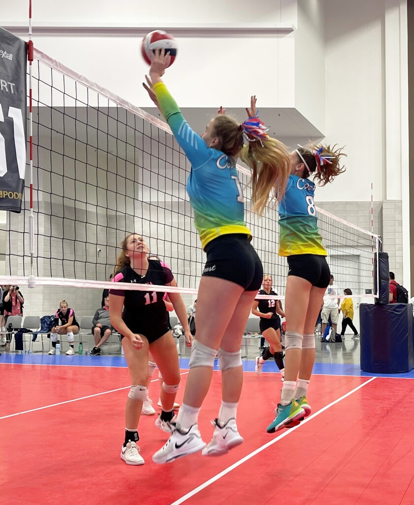 Del Norte High's Dana Branavets, center, during a Coast Volleyball Club game.