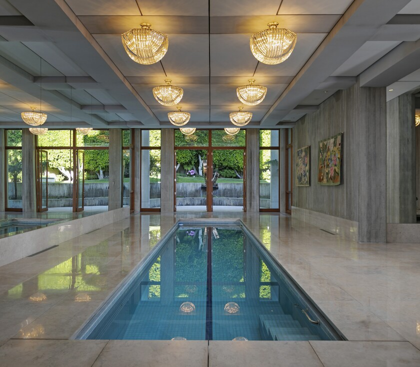 Our splashy Home of the Week in Beverly Hills features indoor and outdoor swimming pools.