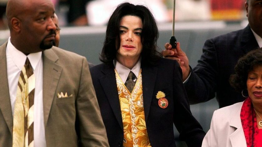 In this May 25, 2005, photo, Michael Jackson arrives at the Santa Barbara County Courthouse for his child molestation trial in Santa Maria, Calif. A documentary film about two boys who accused Michael Jackson of sexual abuse is set to premiere at the Sundance Film Festival.