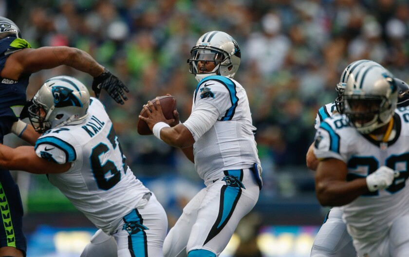 Former Panthers center Ryan Kalil (67) protects for quarterback Cam Newton, now reportedly a member of the Patriots.