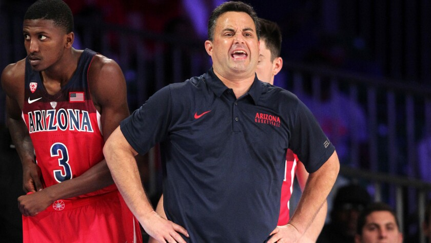 Arizona coach Sean Miller shouts instructions to his team during their loss to SMU on Thursday.