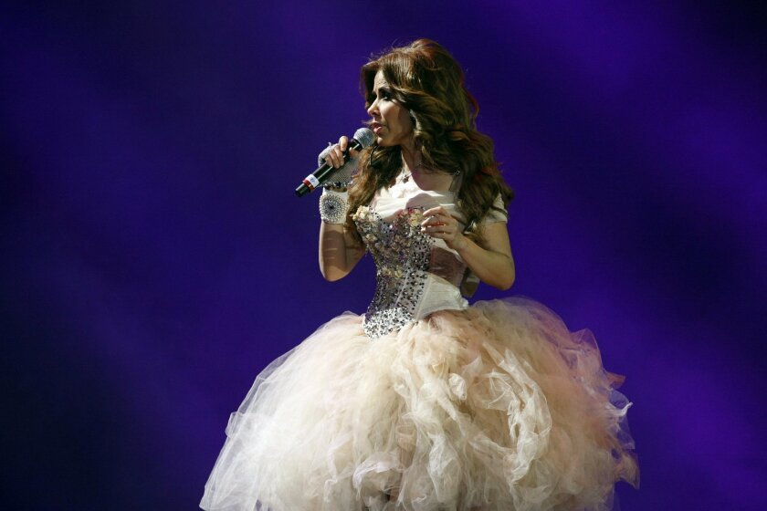 In this March 1, 2013, file photo, Mexican singer Gloria Trevi performs at the Vina del Mar International Song Festival in Vina del Mar, Chile.
