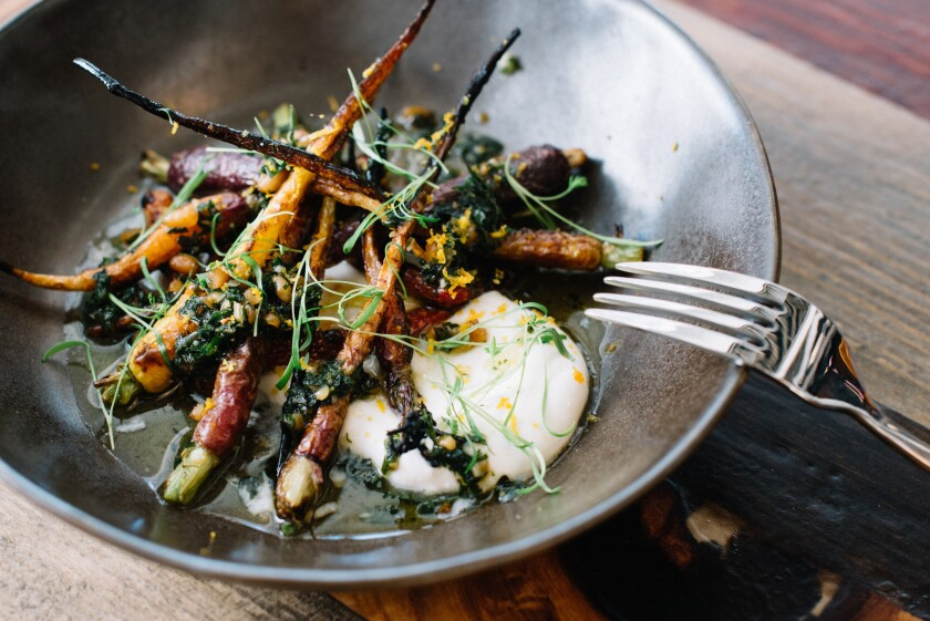 "Biga's tagline is ""cucinato a legno,"" or wood-fired, like these charred carrots. The downtown San Diego restaurant is participating in the inaugural Farm to Fork Week, which kicks off Saturday at Biga with a hog roast."