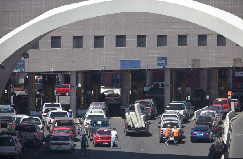 This June 1, 2009 file photo shows vehicles waiting to enter the U.S. through The Dennis DeConcini Port of Entry in downtown Nogales, Ariz. Authorities fear a drainage tunnel that sits underneath the U.S.-Mexico port of entry could collapse any minute, potentially sending cars underground or shutte