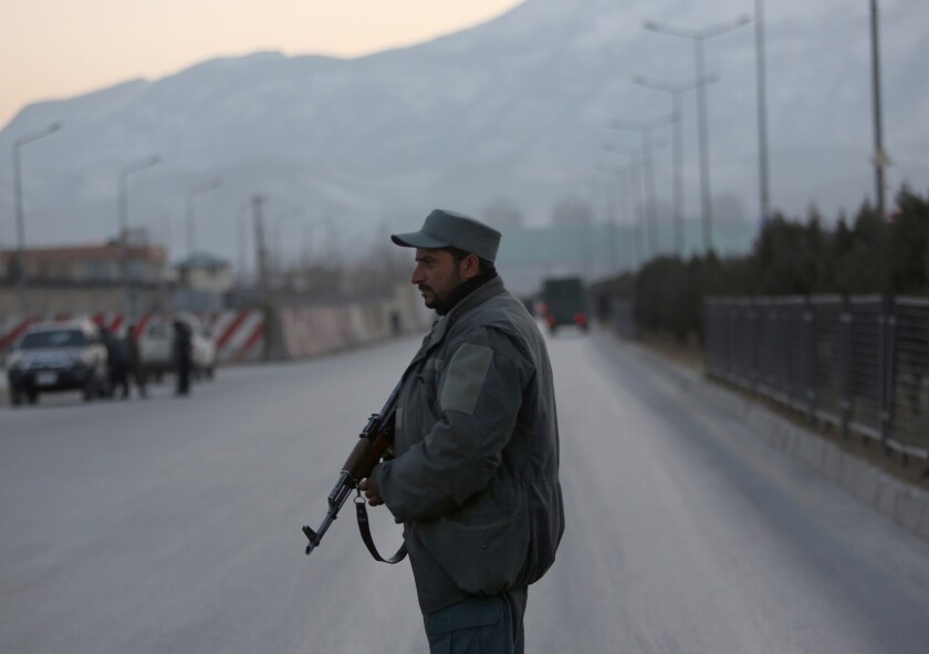 A member of the Afghan security forces stands guard near the site of two blasts in Kabul on Jan. 10, 2017.