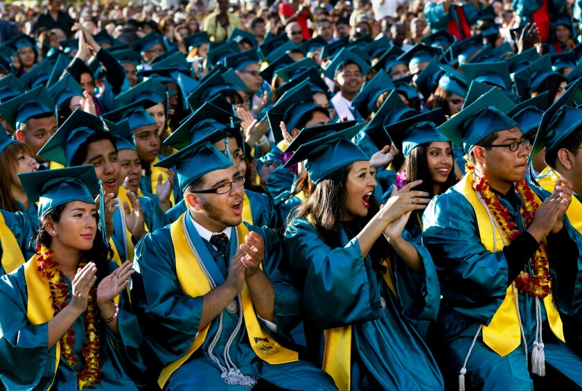 Seniors cheer during the 2013 graduation ceremony for the Ramon C. Cortines School of Visual & Performing Arts in Los Angeles.