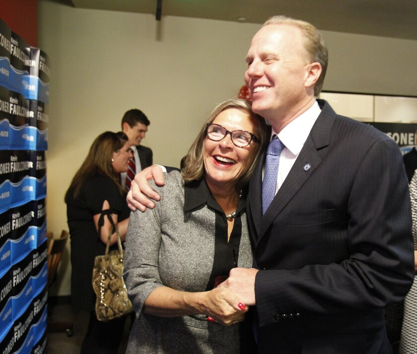 Candidate Kevin Faulconer and his mother, Kay Faulconer Boger hug as they watch returns come in showing Faulconer leading opponent David Alvarez by a comfortable margin.