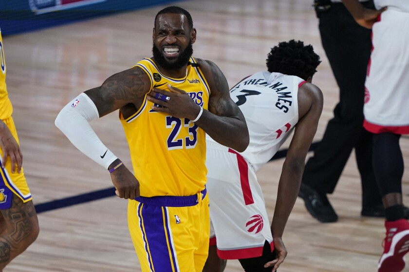 The Lakers' LeBron James reacts after a play against the Raptors during the second half Aug. 1, 2020.