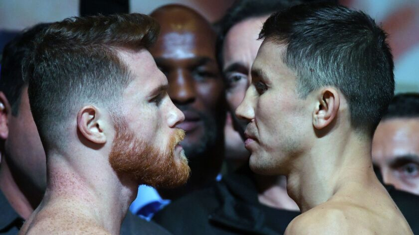Canelo Alvarez, left, and Gennady Golovkin face off before last year's fight.