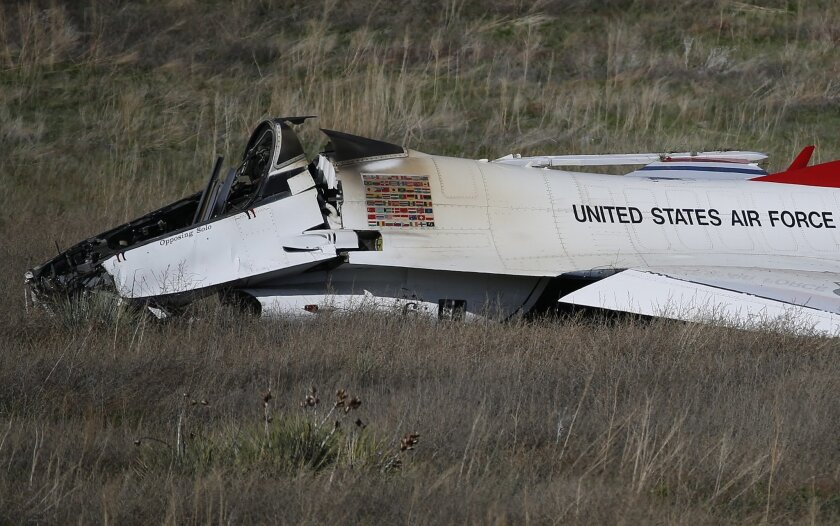 A U.S. Air Force Thunderbird rests in a field where it crashed following a flyover performance at a commencement for Air Force Academy cadets, south of Colorado Springs, Colo.,  Thursday, June 2, 2016. The pilot ejected safely from the jet. (AP Photo/Brennan Linsley)